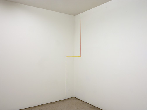 Fred Sandback / Untitled  1990 3-part corner construction  Height: 228.6 cm Red, yellow and blue acrylic yarn FLS#2488.2