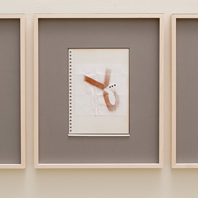 Richard Tuttle / 14 Drawings for Village VI Untitled, No. 2  2004  paper: 21 x 14.8 cm / pp: 36.7 x 30.5 cm gouache, india ink, spray in bronze and collage on paper