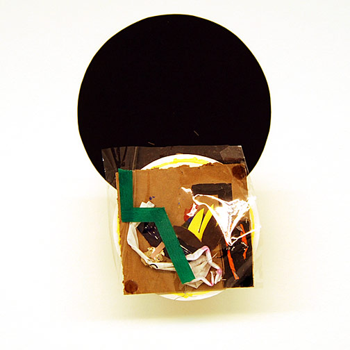 Richard Tuttle / Craft #11  2008 51.5 x 36 x 14 cm cardboard, paper, wire, wood, staple, silicone, tape, plastic and acrylic paint mounted on painted cardboard circle on wood on black cardboard circle